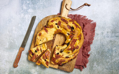 Crown-shaped savory cake filled with salame calabrese and olives